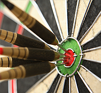 dart board with dart in bulleye link to perfectionism resources